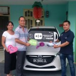 Foto Penyerahan Unit 2 Sales Marketing Mobil Dealer Mazda Medan Chandra Putra